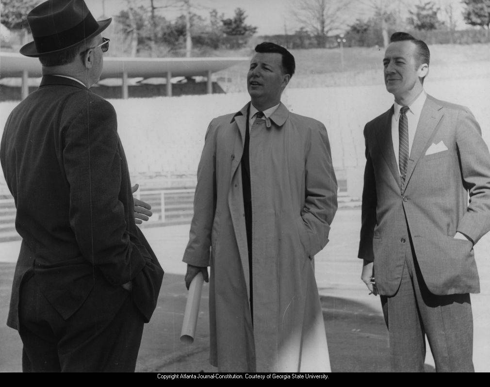 Atlanta Mayor Hartsfield with Albert Coleman (music) and Pittman Corry (dance), at Chastain Park amphitheater, discussing plans for Atlanta centennial celebrations, Atlanta, Georgia, March 1961.